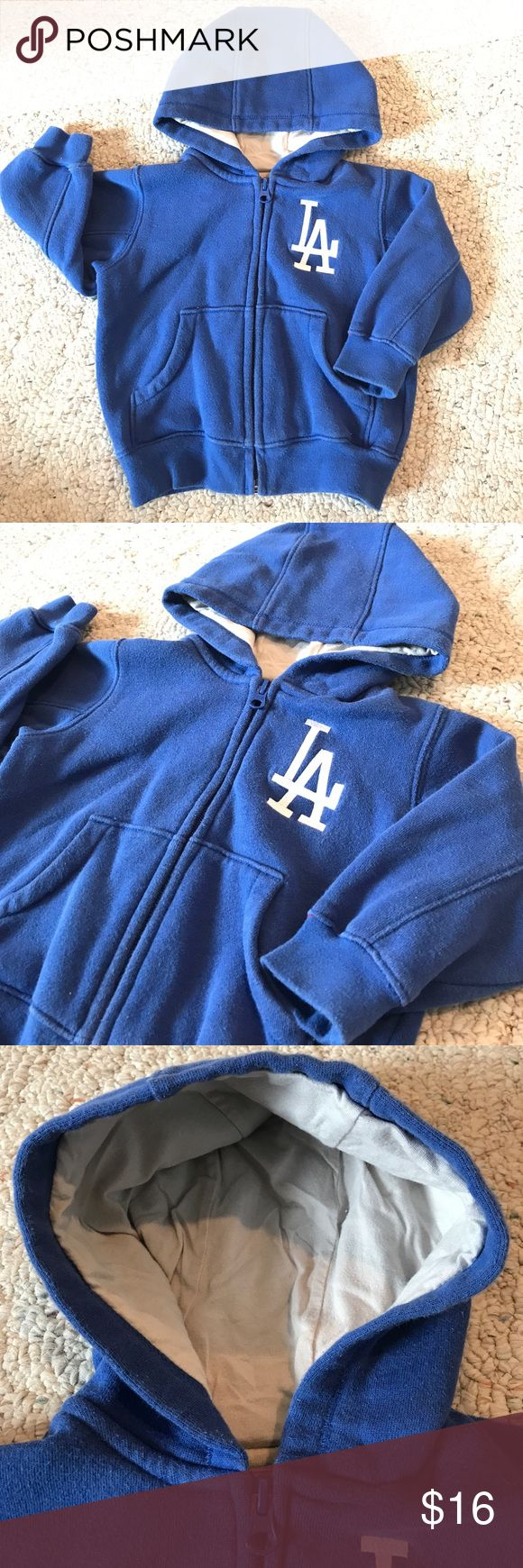 ⚾️ LA Dodgers Toddler Hoodie Jacket ⚾️ Soft and warm with a jersey-lined hood. This jacket is in good condition with no holes or stains. Slight fading from washing, but is ready for your little one! Comes from a smoke and pet-free home. 🌺 Make an Offer or Bundle & Save 🌺 Shirts & Tops Sweatshirts & Hoodies