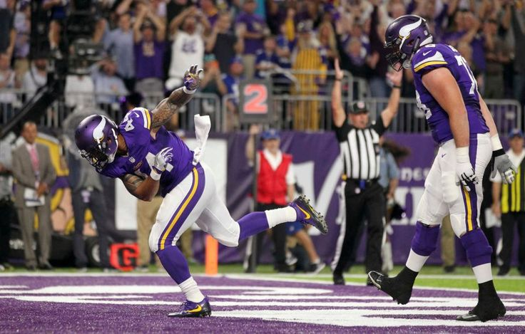 Monday Night Football: Giants vs. Vikings:   October 3, 2016  -  24 - 10, Vikings  -    Minnesota Vikings running back Matt Asiata, left, celebrates after scoring on a one-yard touchdown run during the first half of an NFL game against the New York Giants, Monday, Oct. 3, 2016, in Minneapolis.
