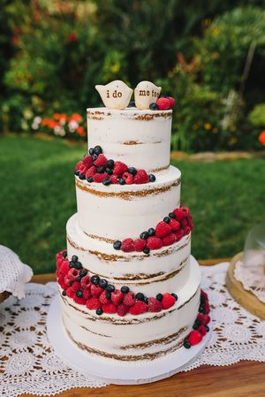 Naked Berry Wedding Cake - Sugar Lane Cake Shop. #cakeinnewyork #caketoppers #weddingcake #customcaketoppers