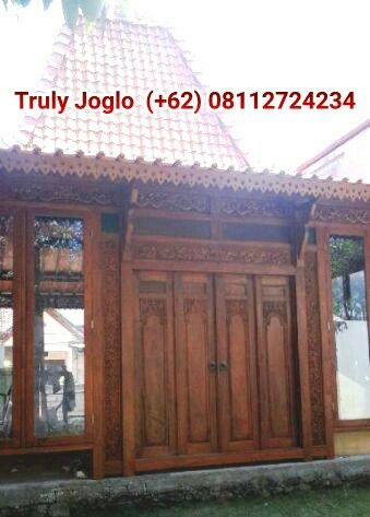 """A close look at Javanese """"Joglo"""" House. There is a carved joglo inside with its carved """"tumpangsari"""" and tiles."""
