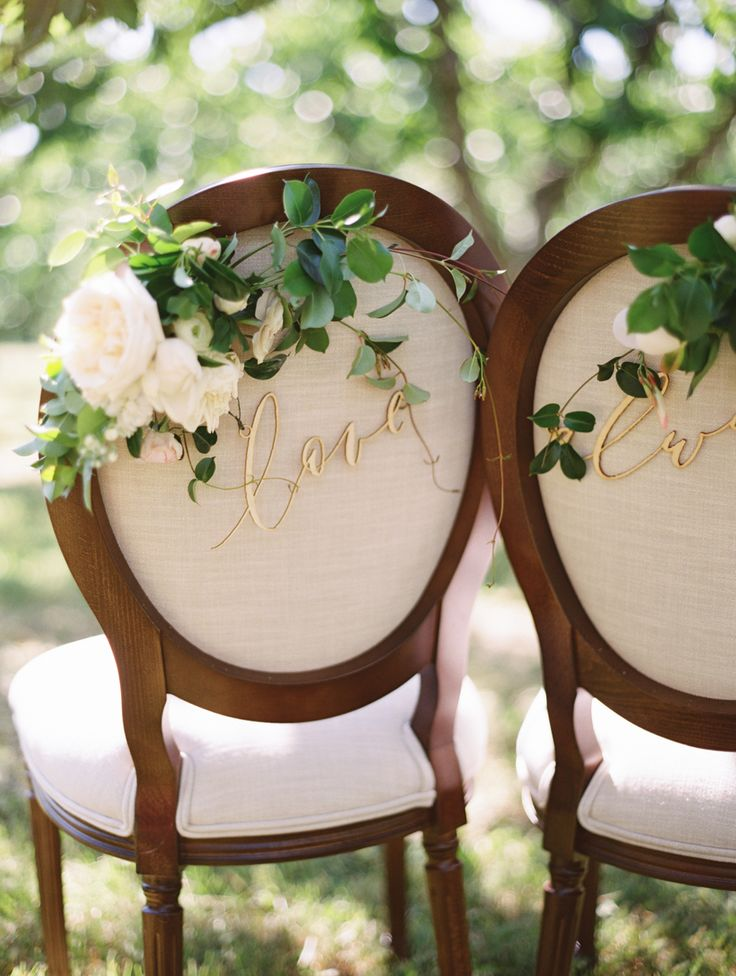Elegant wedding chairs topped with roses: Photography: Brumley & Wells - brumleyandwells.com   Read More on SMP: http://www.stylemepretty.com/2016/10/03//