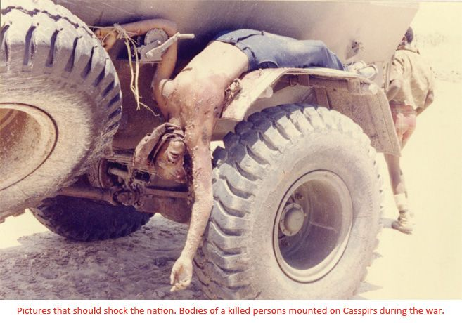 Dead Freedom Fighter's body tied to jeep -Never Forget!