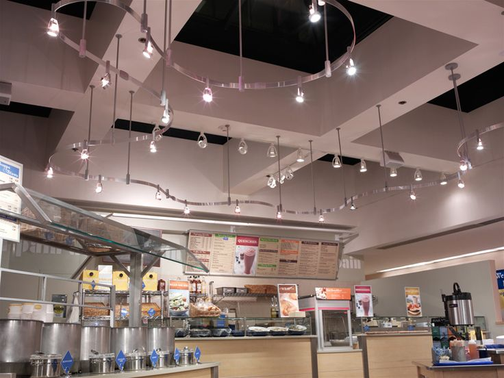 Juno flex 12 trac system artistically winds across the ceiling and illuminates the food