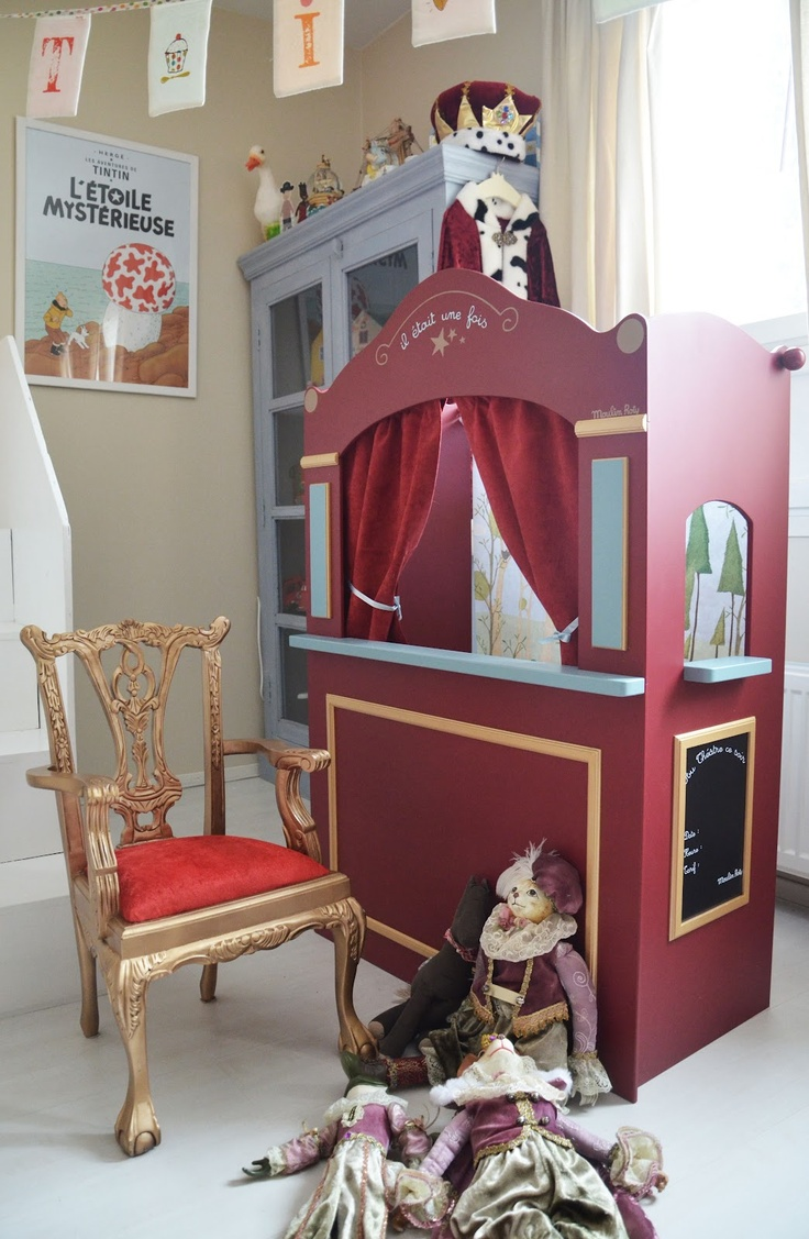 puppet theater. chalkboard sign above to write in the show.