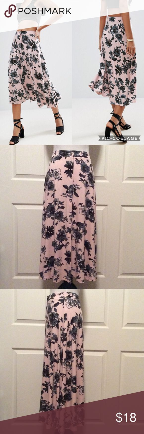 """Just In💕 Floral Print Snap Front Skirt Blush and black floral print midi skirt with snap front detail. Great condition. Comfy flat elastic waistband...and the fabric feels like your favorite soft tee. Measured laying flat, across and down. 13""""W, (stretches to approx 15.5""""), 35""""L. ASOS Skirts Midi"""