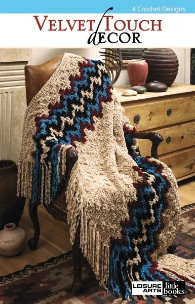 Velvet Touch Decor eBook - Enrich your home with crocheted luxury! Bulky and super-bulky yarns yield warm and soothing accessories with a kitten-soft feel. Revel in the richness of a Western Trails Blanket. Relax under the warmth of a Chevron Comforter.