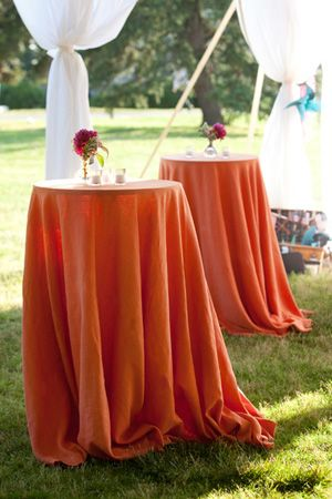 Orange Table Linens Under A White Sperry Tent.