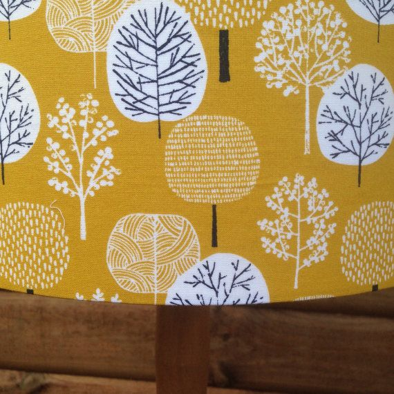 Yellow Mustard Coloured Background with stylised tree design.  All the lampshades are handmade by me (Anne) in Paisley, Scotland.  The size