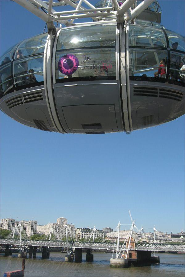 Beautiful London Eye Ferris Wheel  - Millennium Wheel at River Thames - and Hungerford Bridge - London, UK, Great Britain