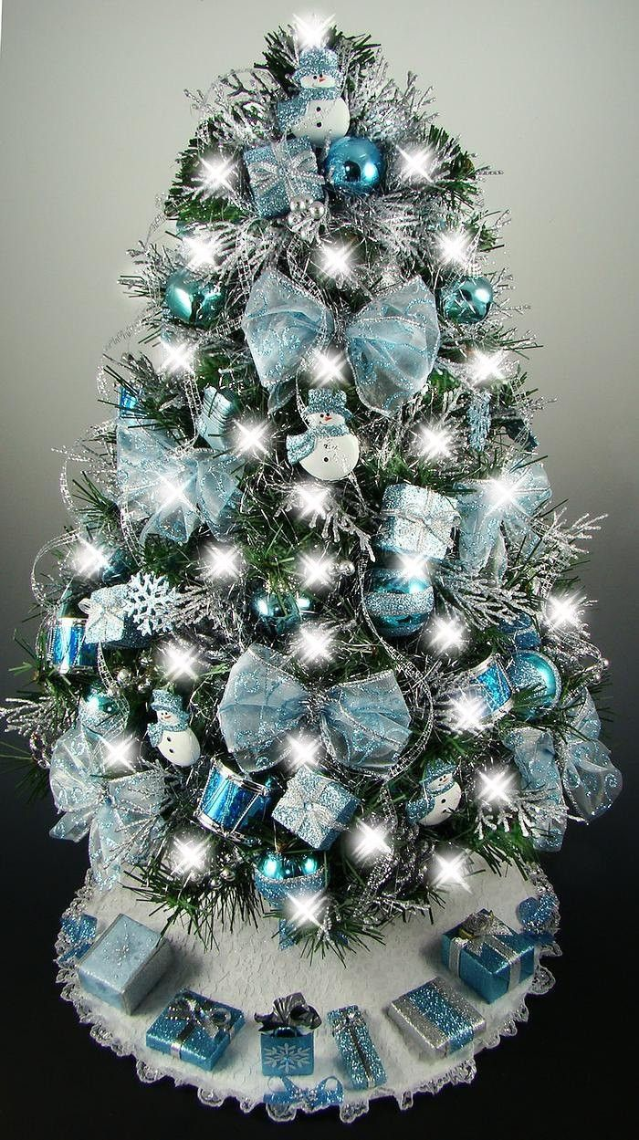 Decorated mini tabletop christmas tree turquoise blue silver snowman theme 50 lights tree skirt reserved for