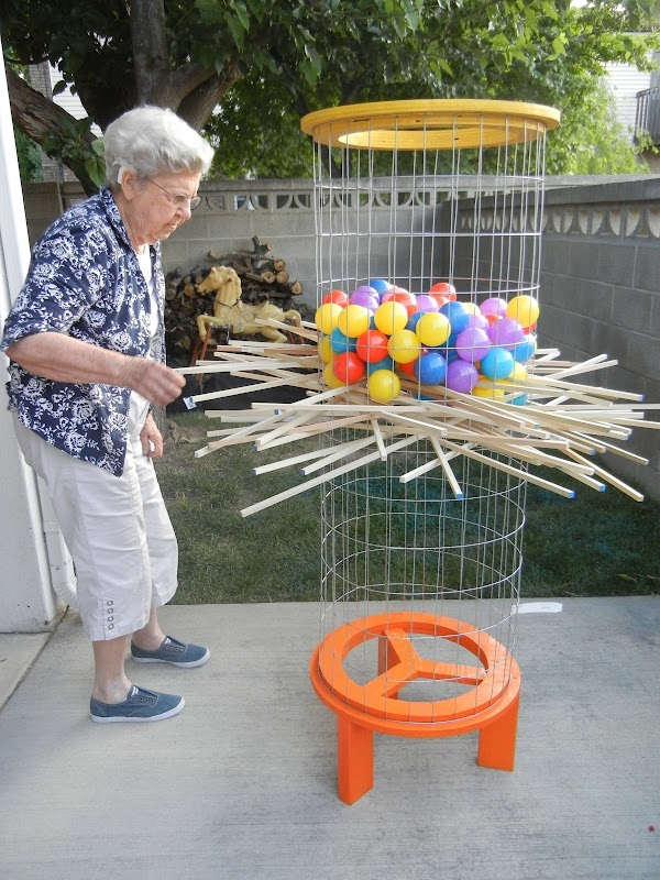 Kerplunk a game I played in the 70's with pixy sticks and marbles..