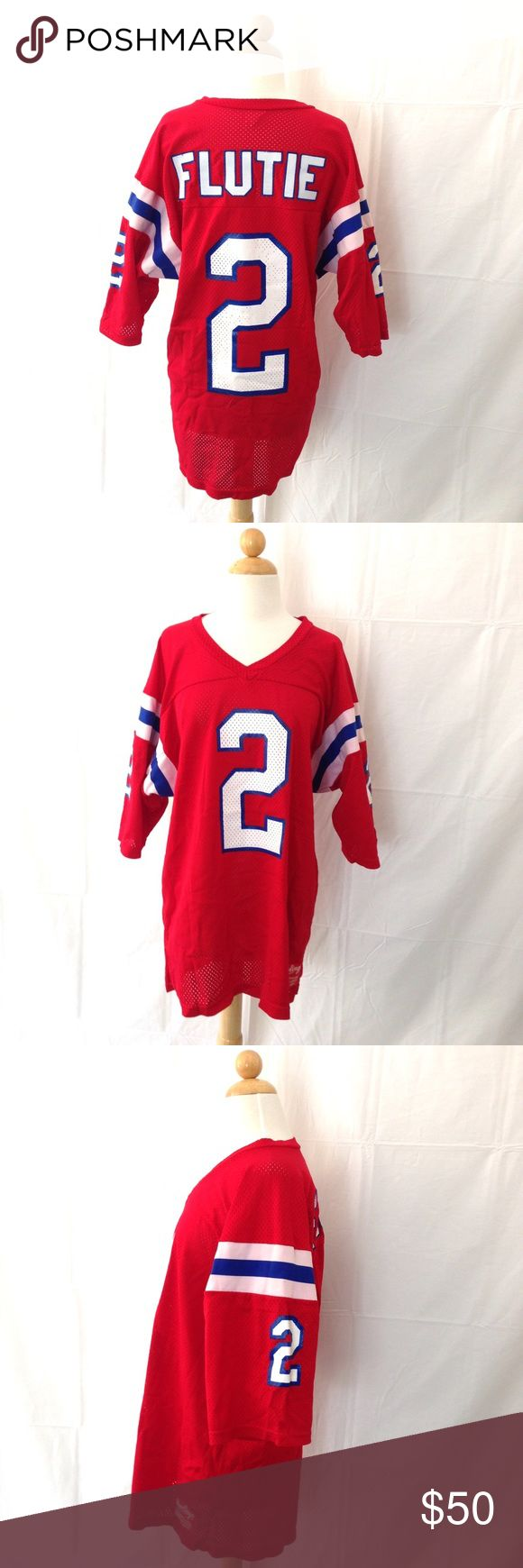 Doug Flutie Rawlings Red Buffalo Bills Jersey Flutie is in the College and Canadian Football Hall of Fame and was a Heisman Trophy winner. This jersey is in pretty good shape, has one spot with what looks like a little misplaced paint. It is a size Large. Measurements shown are first pit to pit, second neck to bottom. Rawlings Shirts Tees - Short Sleeve