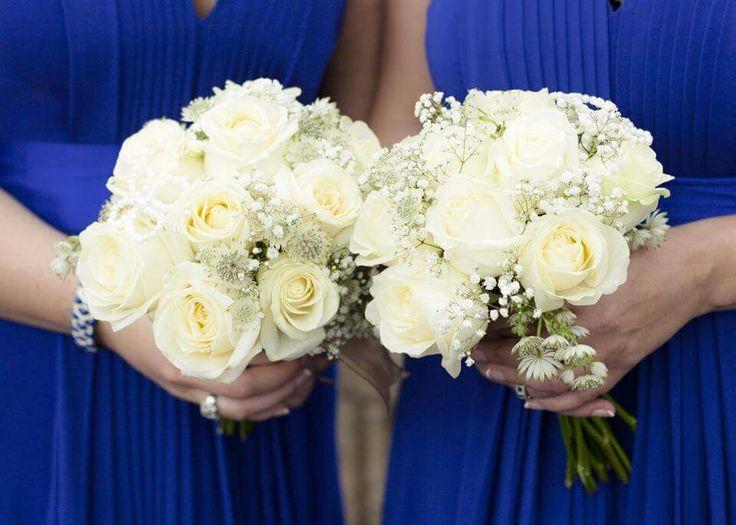 Cobalt bridesmaid dresses. White bridesmaid bouquet