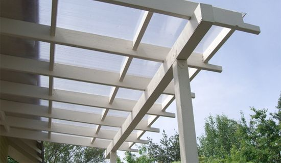 Plexiglass Pergola Roof. Perfect. Keeps you dry but still lets bright light into the house. Some day!