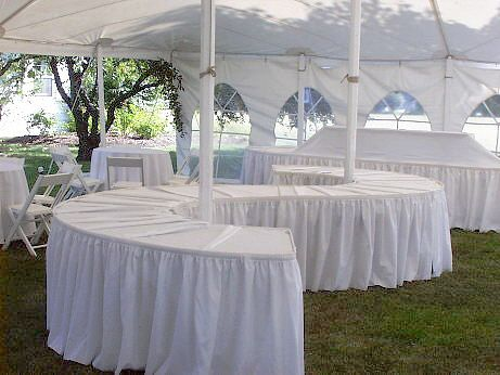 Always use table linen and table skirting on your food display and food service tables.  It dresses your tables to the floor and gives them a finished look.    http://www.camelotspecialevents.com/Linen-Rental.htm