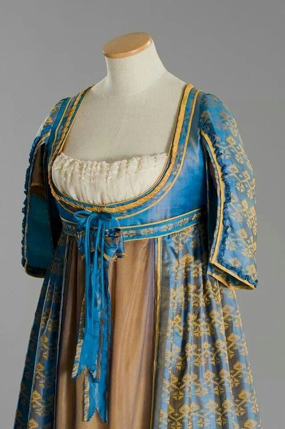 Regency gown with open robe of warp printed silk. Late 1790s or early 1800s.