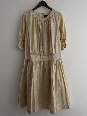 Beautiful vintage looking dress . pleated . off white . antique ?
