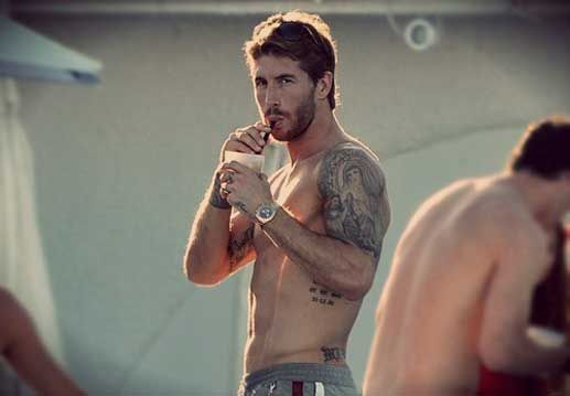 """Sergio Ramos' body is full of tattoo art. On his left bicep: the dates 9/11 and 3/11 – referring to the terrorist attacks on the United States in 2001 and Madrid in 2004 – with the phrase """"lies in the memory of those alive"""". He also has one in remembrance of former Sevilla teammate Antonio Puerta, who died aged 22 from a series of heart attacks during a La Liga game in 2007. The tribal tattoo on his right wrist is identical to the one his brother has, also inked at the same place."""