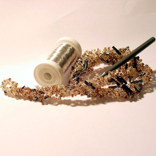 Craft wire, used to string jewelry, makes the energy levels for the potassium atom model.