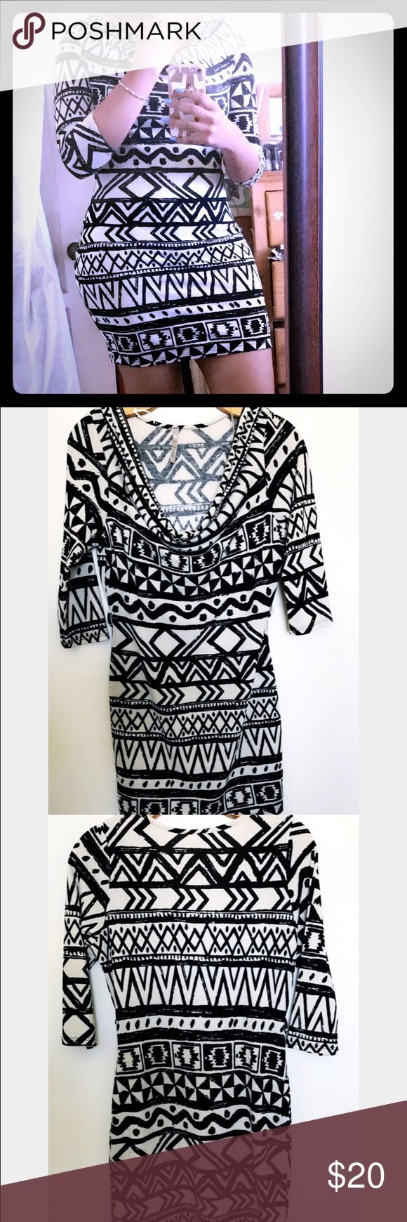 Aztec print dress Aztec print black and white dress with 3/4 sleeve with a scoop neck. Great from a dinner party with friends, goes just a little bit above the knee Dresses Midi
