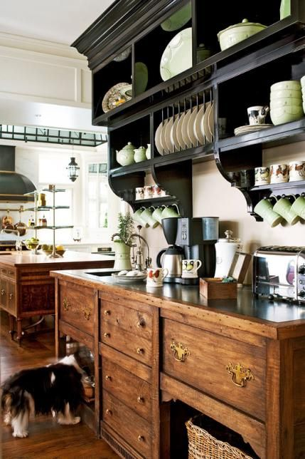 Why We Love It Because the handsome custom-built hutch, including the wall-hung shelves above it, supplies everything the family—and their dog—need for breakfast. Two built-in refrigerator drawers from U-Line can also be used as freezer drawers for ice when the the family entertains.