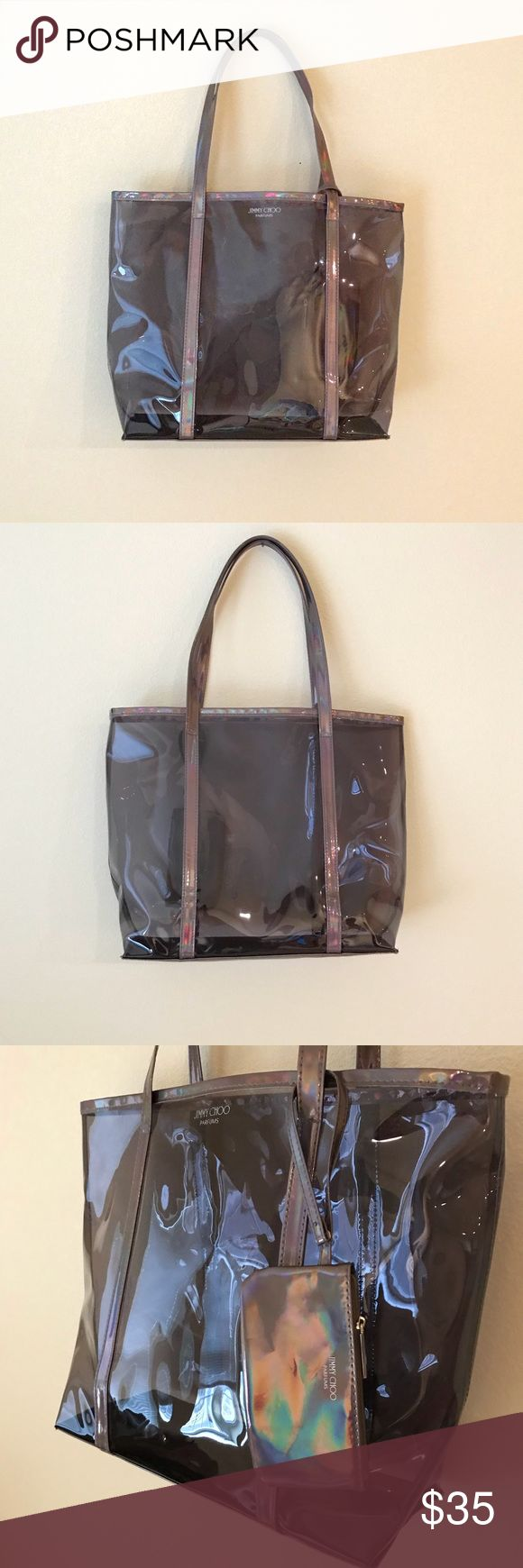 "Jimmy Choo Parfums Iridescent Purple Clear Tote Comes with a small pouch. Some creasing here & there. Approximate measurements when flat: Tote - length 14"" width 5 1/2"" height 13 1/4"" (no handle) 22"" (with handle). Small pouch - length 6"" height 3 1/2"" Jimmy Choo Bags Totes"