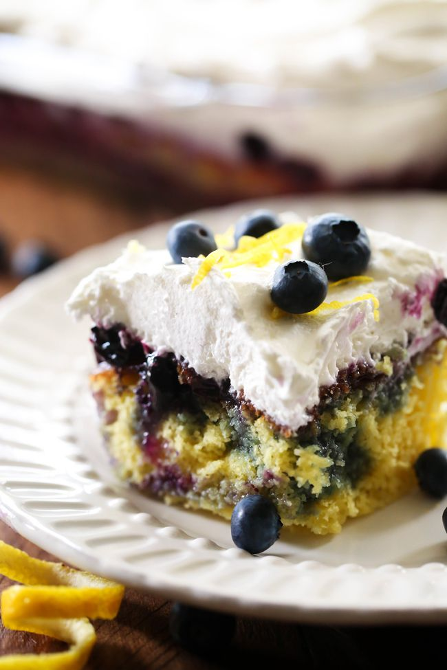 Lemon Blueberry Poke Cake... this recipe is easy, delicious and refreshing! The cake is infused with such a light and incredible flavor making each bite equally as tasty as the last!