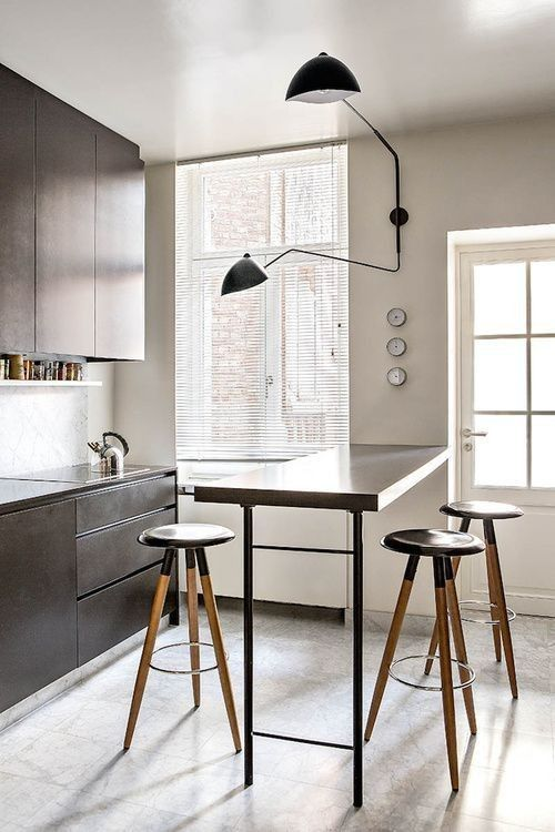 Now that's a sconce. Crazy love. Serge Mouille Sconce in Kitchen | Remodelista