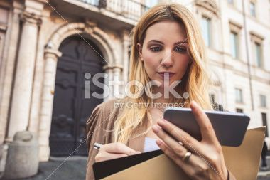 Professional woman holding file folder and contracts Royalty Free Stock Photo