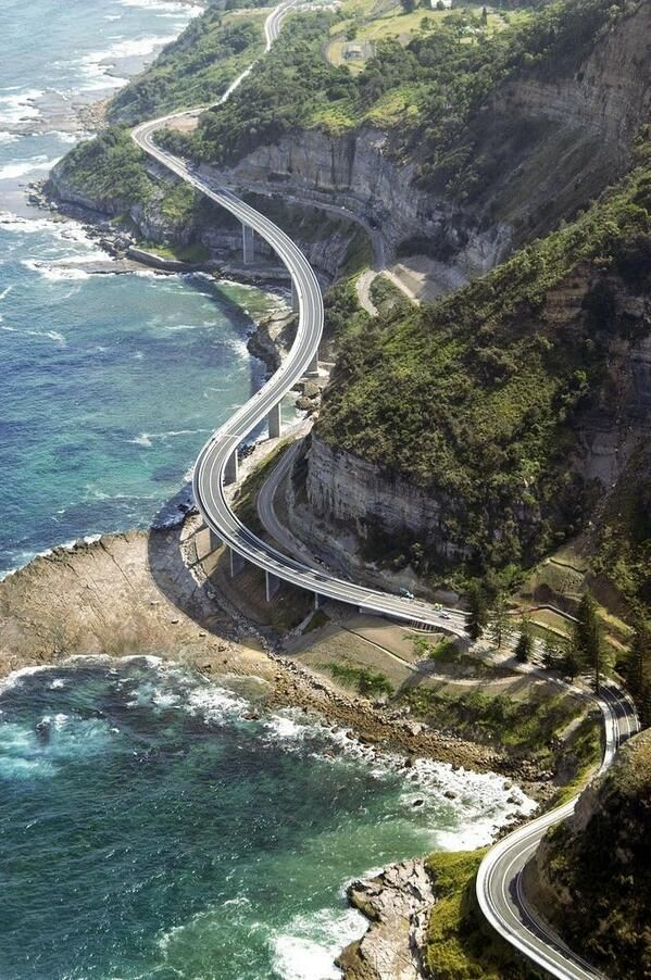 The Sea Cliff Bridge is a balanced cantilever bridge located in the northern Illawarra region of New South Wales, Australia. The $52 million bridge links the coastal villages of Coalcliff and Clifton. Featuring two lanes of traffic, a cycleway and a walkway, the bridge is a feature of the scenic Lawrence Hargrave Drive.