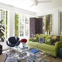 Jonathan Adler - living rooms - zebra rug, navy zebra rug, navy blue zebra rug, blue zebra rug, jonathan adler zebra rug, meurice cocktail table, nickel and glass coffee tables, side by side coffee tables, silver bamboo coffee table, square coffee table, faux bamboo coffee table, green sofa, floor screen, ceiling fan, living room ceiling fan, Meurice 2 Tier Table, Zebra Rug,