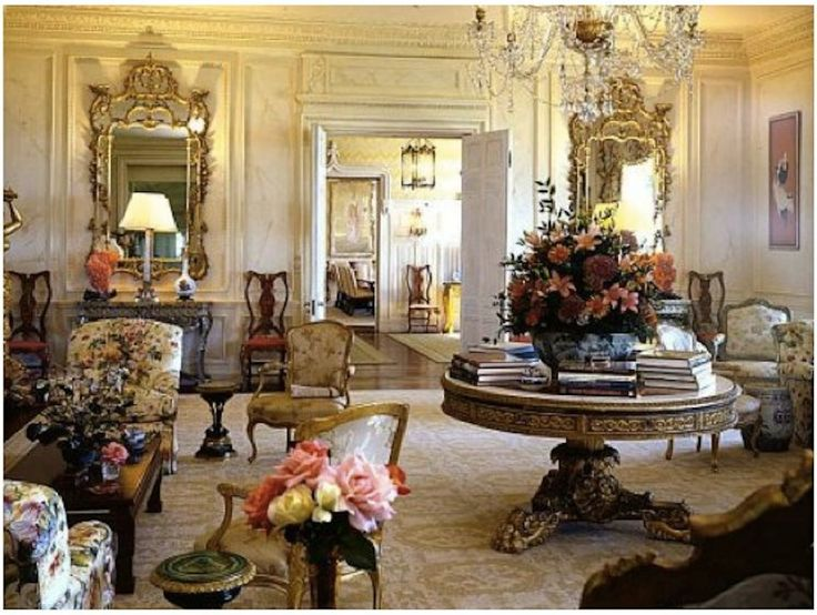 I would love a big round table with lots of stacked books and a large flower arrangement in my living room.