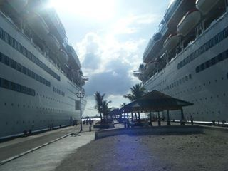 Royal Carribean Cruise liners in bays next to eachother