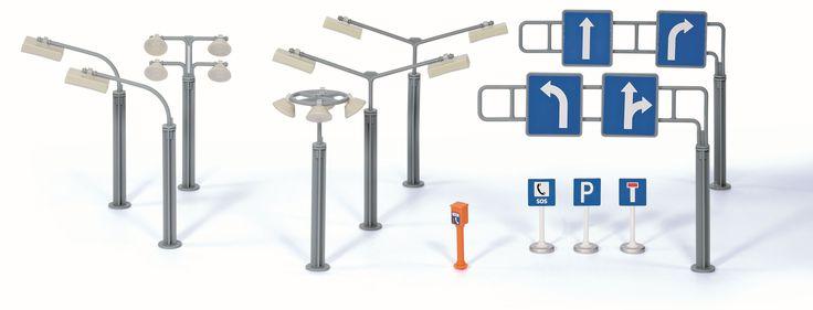 Een uitbreiding bestaande uit verschillende straatverlichting en verkeersborden.   Afmeting: 45x175x115 mm - Verkeersborden Siku