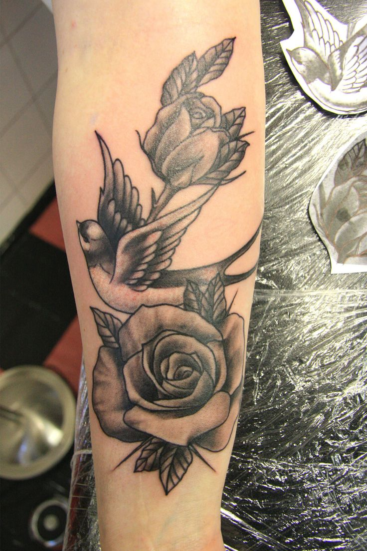 Black  grey #swallow and #roses #tattoo on forearm by Susy