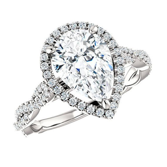 10x7mm Pear Forever One Moissanite & Diamond Halo Twisted