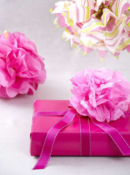 How to make a tissue paper flower for gift wrapping.