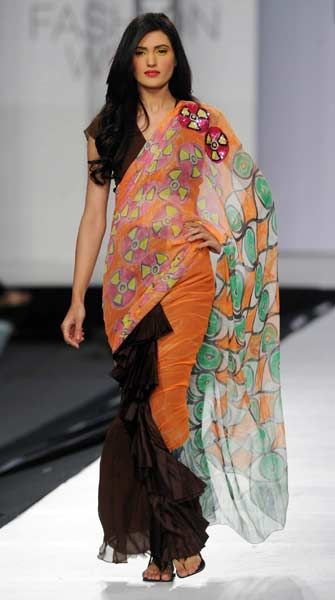 A model presents a creation by Pakistani designers Sadaf Maiateree and Anjum Ali on the last day of the Pakistan Fashion Design Council (PFDC) in Lahore late April 16, 2012.
