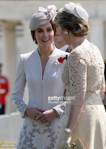 Princess Catherine Duchess of Cambridge speaks with Queen Mathilde of Belgium at The Tyne Cot Commonwealth War Graves Cemetery in Zonnebeke on July...