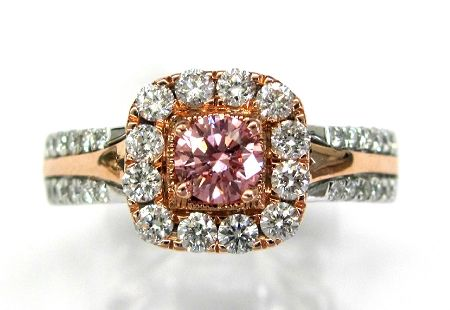 Ladies 14kt white and rose gold diamond ring. Ring is set with 1 brilliant round cut color treated pink diamond weighing .33ct and 36 brilliant round cut white diamonds weighing .77ct. A total of approximately 1ct.