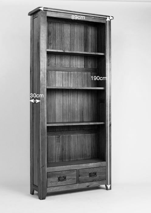 Westbury Oak Tall Bookcase - Standing over six foot tall, our Westbury reclaimed oak bookcase offers plenty of storage for your favourite page-turners, family photographs, mementoes and collectables. Made from reclaimed oak, this piece has all the warmth and homely charm you would expect from a Westbury design. It features three shelves and two handy drawers finished with antique-style brass handles.