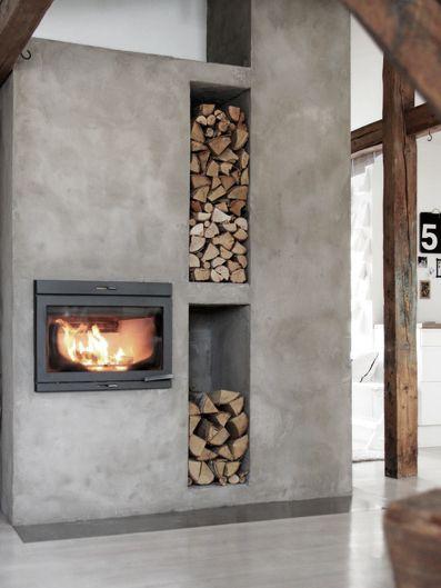 concrete fireplace with firewood storage