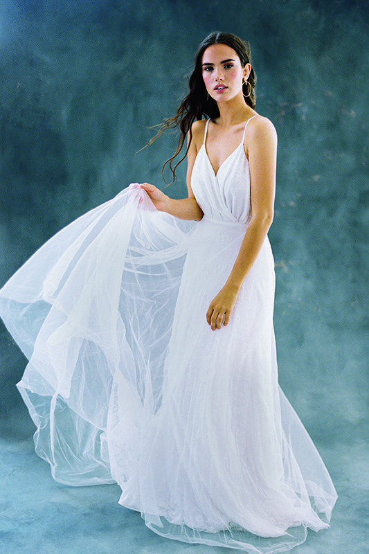 F101 Aria - Aria's simple sleeveless silhouette is frosted with a sheer tulle overskirt.