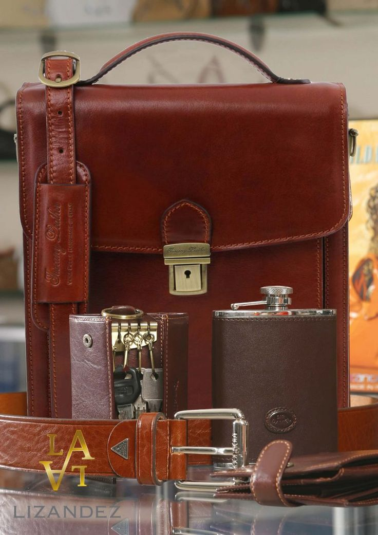 The men's bag that carry's it all, keys, wallet hip flask