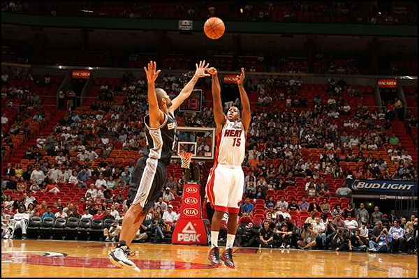 Mario Chalmers shoots a three over Tony Parker of the San Antonio Spurs