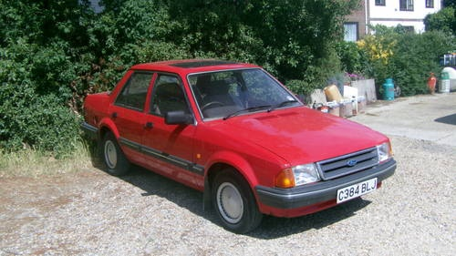 Next up was a 1300 GL Ford Orion (that I crashed on my back from a Go Kart event).  It was red, had a radio and lacked any real power (a theme was developing)
