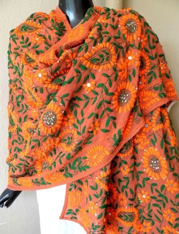 This gorgeous orange & green phulkari work georgette dupatta has a unique color combination, and heavy embroidery. It has been han embroidered in a vibrant colored floral pattern, with wool thread and sequins - See more at: http://giftpiper.com/Handembroidered-Phulkari-Work-Georgette-Dupatta-Orange-Green-id-320573.html#sthash.QL2SC1Lt.dpuf