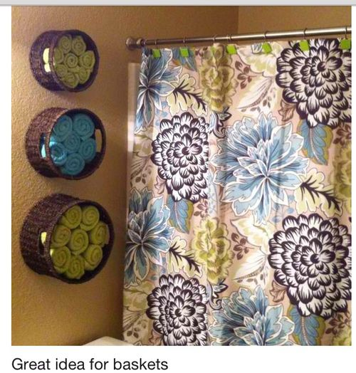 Love the use of baskets on the wall to hold towels, etc. (Really love that shower curtain! :)