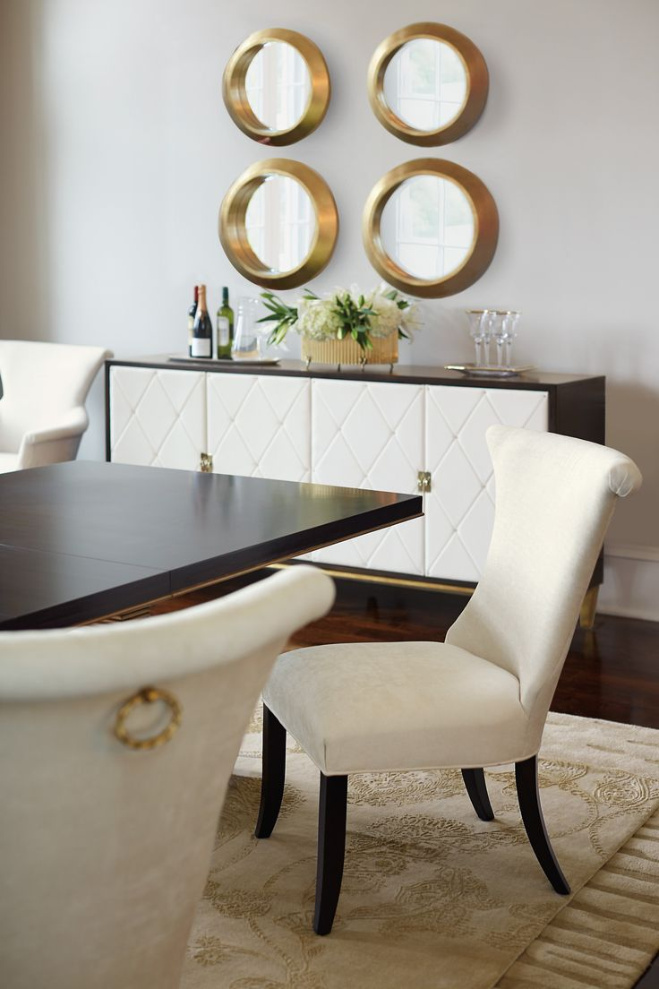 This exquisite button-tufted leather detailed buffet will add elegance to your dining or living room.