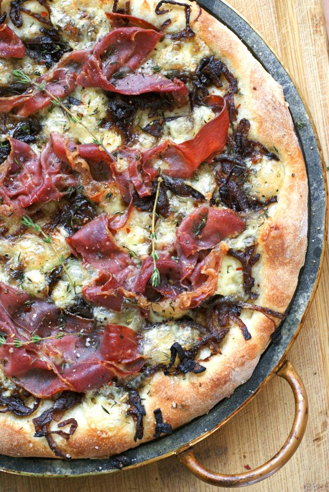 brie prosciutto and caramelized onion pizza and a soapstone pizza pan ...